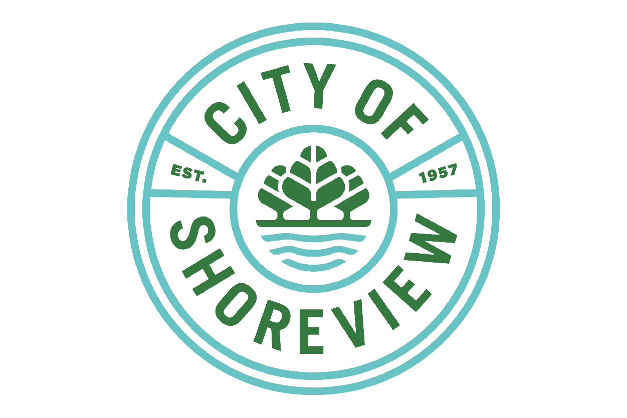 Round logo in green and blue that reads City of Shoreview